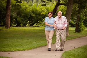 Caregiver and client on a walk